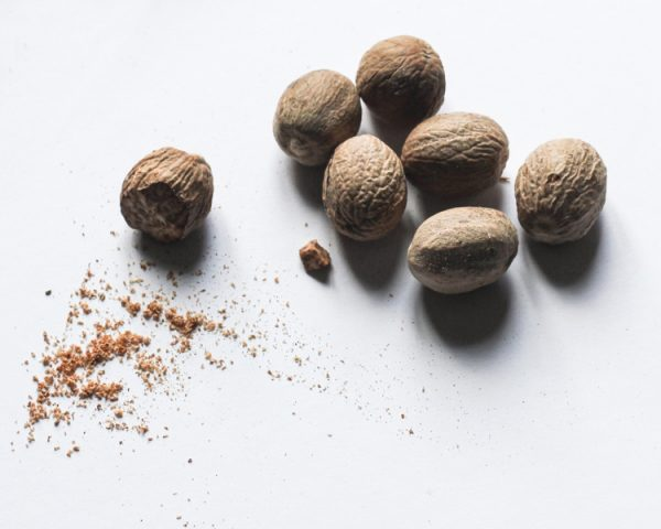 Whole nutmeg , and a pinch of powdered nutmeg